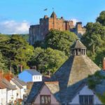 View over the medieval Yarn Market to Dunster Castle (©Steve Bittinger/Flickr)